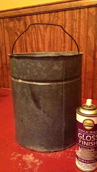 An old metal bucket that has been cleaned and sealed with a gloss varnish.