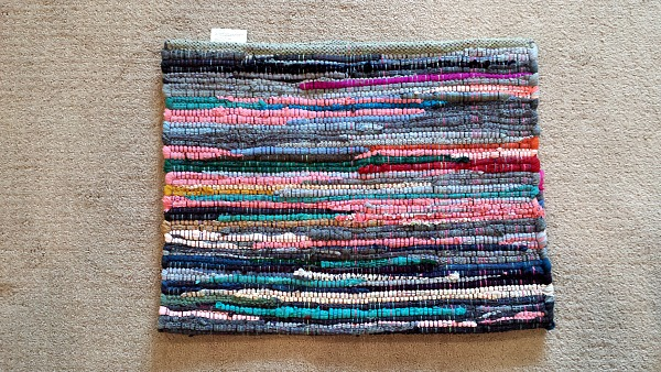 A rag rug to use for a pillow.