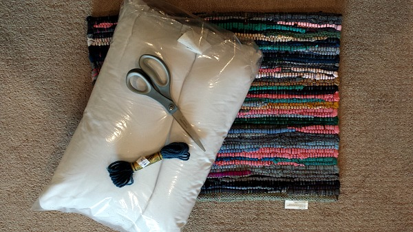 Supplies for a rag rug pillow.