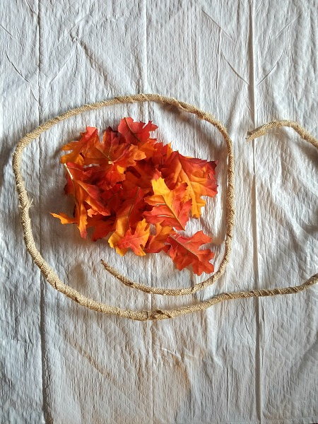 Wire with burlap wrapped around it and fall leaves
