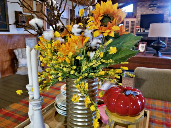 sunflower and cotton stem floral arrangement