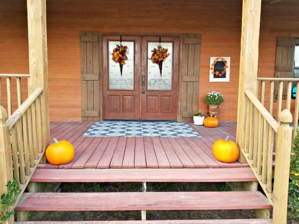 pumpkins and door wreaths