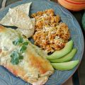 THE Best Chicken Cream Cheese Enchiladas using flour tortillas, cream cheese, chicken, green enchilada sauce, cream of chicken soup, colby jack cheese, taco seasoning, and green chilis.