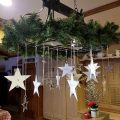 Star ornaments hanging from a light.
